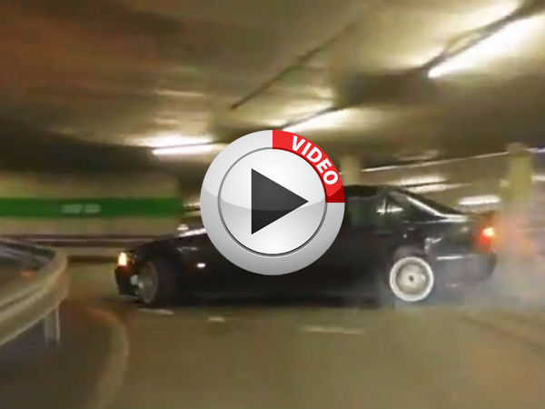 Guy drifts to the top of a parking garage